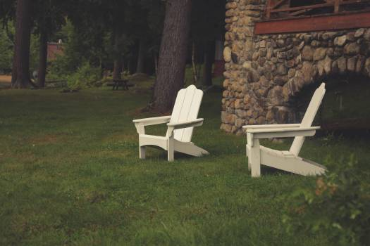 2 White Wooden Armchairs on Green Grass #42431