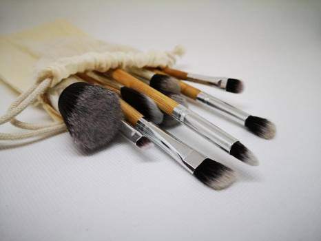 A Group Of Paint Brushes Spill Out Of A Cream Linen Bag #424545