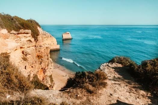 A Golden Beach Below A Cliff #424562