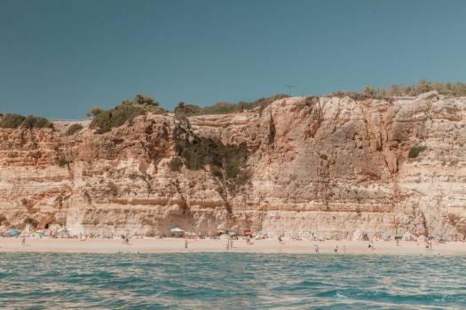 A Long Stretch Of Sandy Beach Under Weather Limestone Cliffs #424568