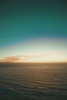 Teal Sky Over Calm Evening Waters #424627