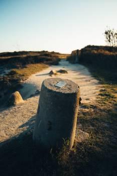 Stone Bollard In Sand #424641