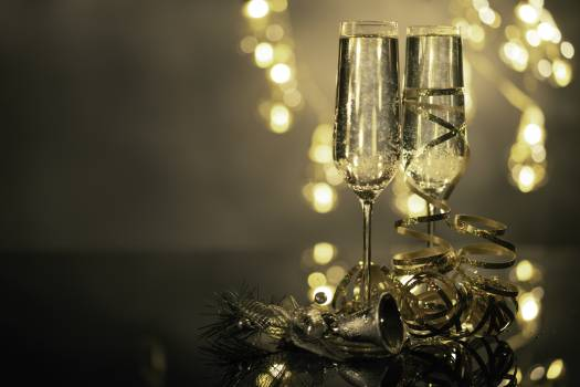 Close-Up Of Two Flute Glasses Filled With Sparkling Wine Wuth Ribbons And Christmas Decor #424771