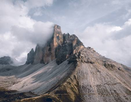 Photo Of Mountains Under Cloudy Sky Free Photo