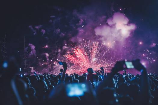 Crowd Watching Pink Fireworks Erupting Into Clouds Of Purple #425274