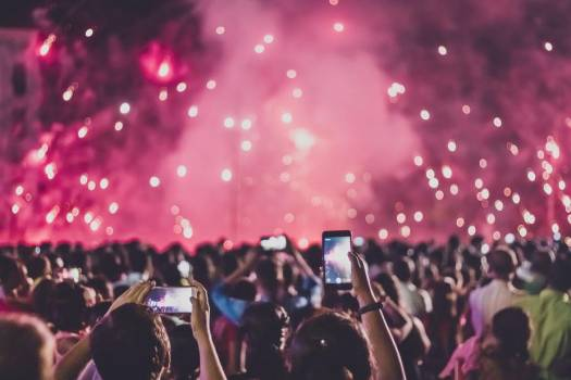 Crowd Capturing Fireworks Display On Cell Phone Cameras #425276