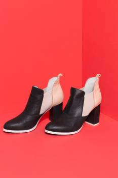 Black And Nude Boots On Red #425516