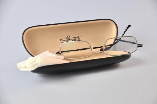 Silver Framed Eyeglasses on Black Eyewear Case Free Photo
