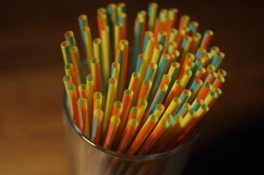 Colorful Plastic Straw on a Glass Container #42860
