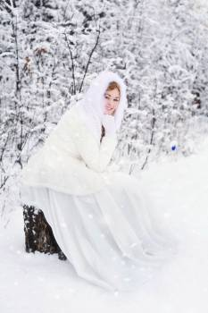 Woman in White Fur Hooded Dress in White Snow Filed #42944