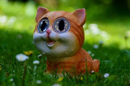 Yellow and Orange Tabby Kitten Figurine on Green Grass Plant #43237