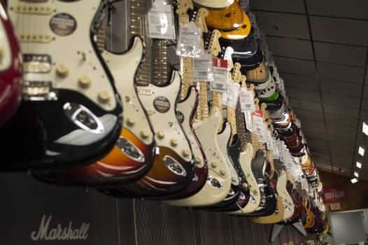 Electric Guitar Hanging Near Wall #43674