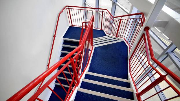 Blue Stairs and Red Handled on White Paint Wall #43822