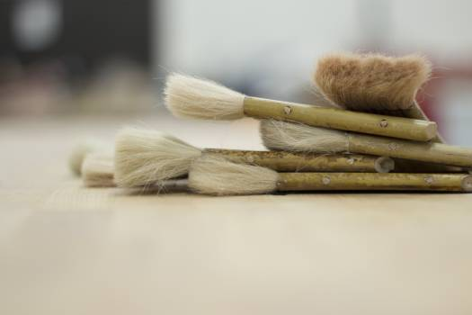 Paintbrush on a Brown Surface Photo Free Photo