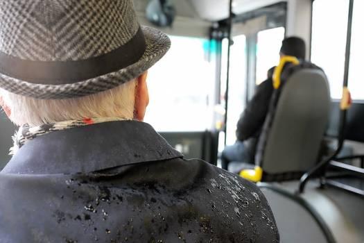 Man Wearing Black Coat While Wet #44421