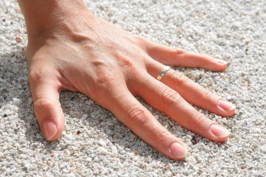 Lef Humand Hand Wearing Silver Ring on the Soil #44686
