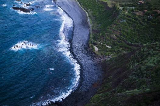 Areal Photo of a Sea Waves Splashing on Sea Sand Beside Mountain #44864