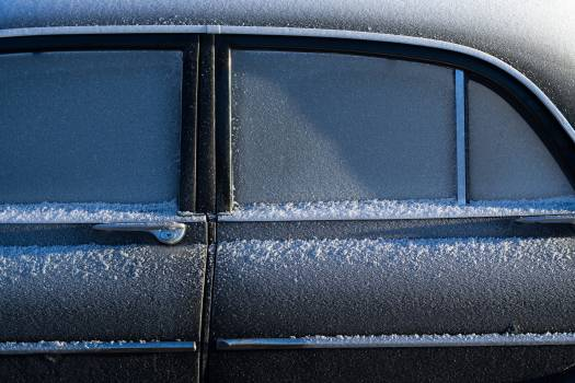Black Sedan With Snow on the Side of the Window Free Photo