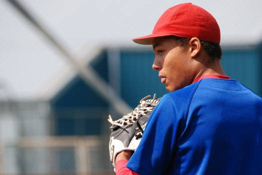 Man in Red Fitted Cap Wearing Blue Shirt With White Leather Baseball Mitt on Hand during Daytime #45131