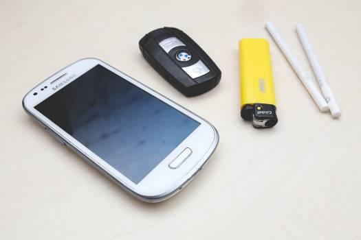 Phone, car key, lighter & cigarettes #45145