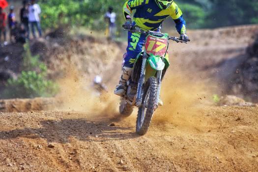Man Riding Green Dirt Motorcycle during Daytime Free Photo