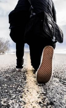 Human on Black Shirt and Pants Kneeling on Road during Daytime Free Photo