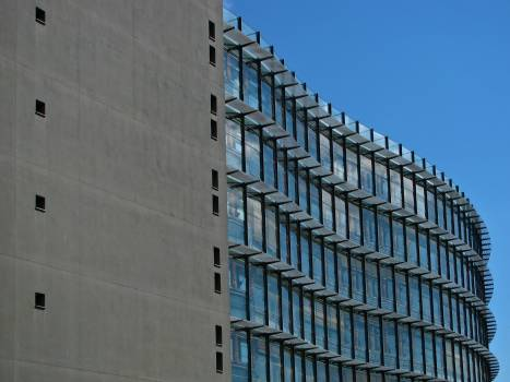 Grey Concrete Building With Blue Windows Free Photo