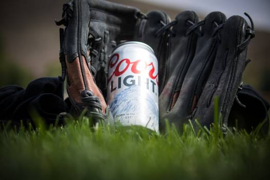 Close Up Photography of Coors Light Beer Near Black Baseball Mitts #46501