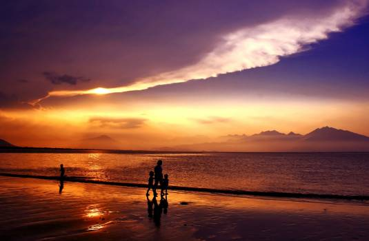 Silhouette of People Walking on Seashore Under Gray and White Clouds during Daytime #46706