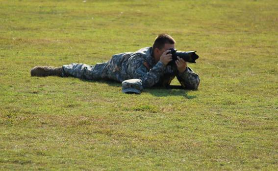Military Crouching on Green Grass Using Dslr Camera during Daytime #46908