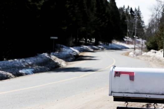 White Metal Mailbox Near Grey Asphalt Road at Day Time Free Photo