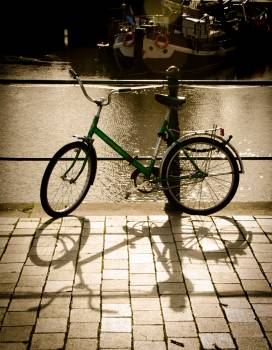 Green Bike Parked Beside the Body of Water #47818