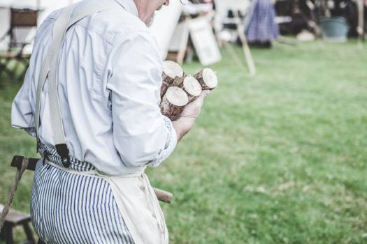 Man in White Dress Shirt Carrying Brown Wood Logs #48123