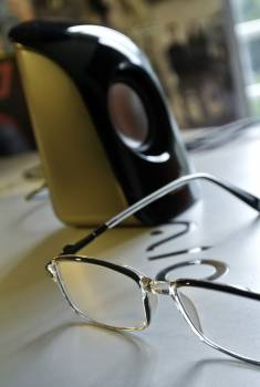 Black Frame Eyeglass Beside Black and White Electric Kettle #48270