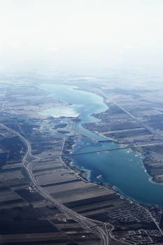 Aerial View of Large Body of Water and Field #48585