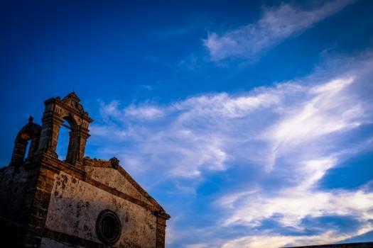 Brown Concrete Chapel Under Cloudy Blue Sky #48647