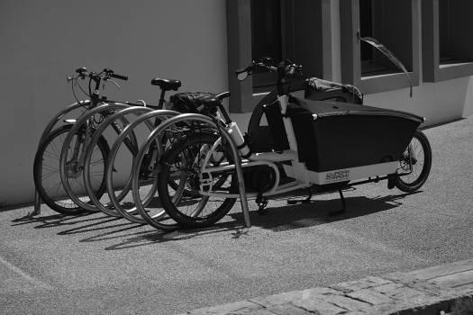 Greyscale Photo of Utility Bike during Daytime Free Photo