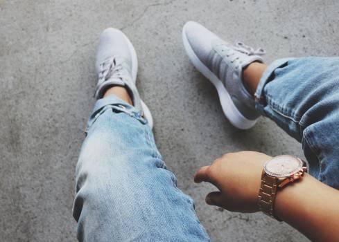 Grey Adidas Sneakers Near Blue Denim Bottoms Free Photo