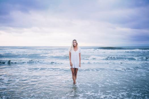 Woman in Standing Body of Water While Wearing White Scoop Neck Top #49884
