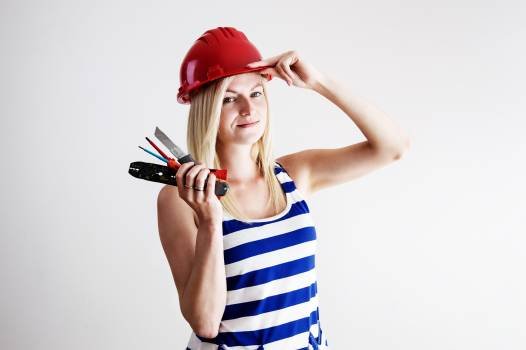 Woman in Blue and White Tank Top Wearing Red Hard Hat #49886