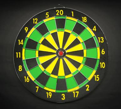 Green Yellow and Black Round Dart Board With Black Background Free Photo