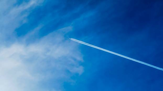 Plane Fling on Sky Leaving Contrailss Free Photo