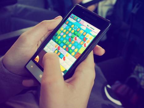 Person Playing Candy Crush on Nokia Smartphone Free Photo
