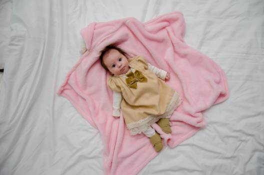 Baby in White and Yellow Dress on Pink Textile #52593