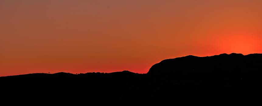 Black Mountain Under Brown Sky during Sunset #52750