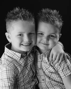 Black and withe boy brothers expression Free Photo