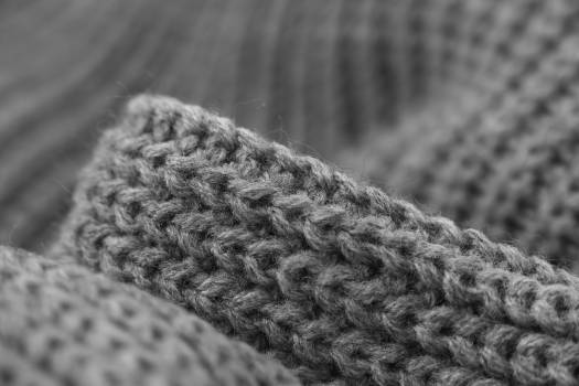 Abstract black and white cardigan sweater close up Free Photo