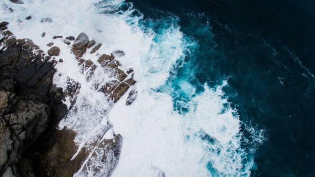Waves splashing on beach Free Photo