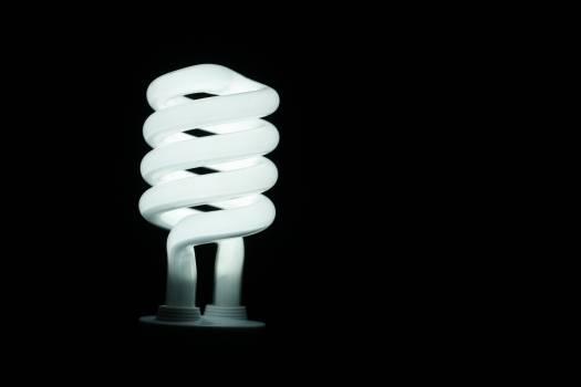 Illuminated Lamp Against Black Background Free Photo