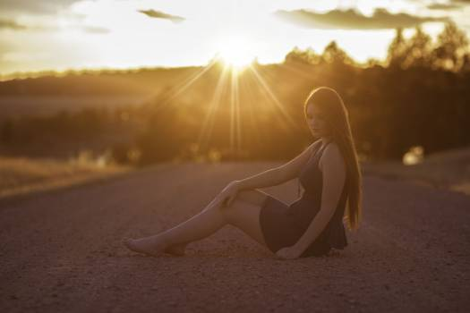 Rear View of Woman Sitting on Floor at Sunrise #60402
